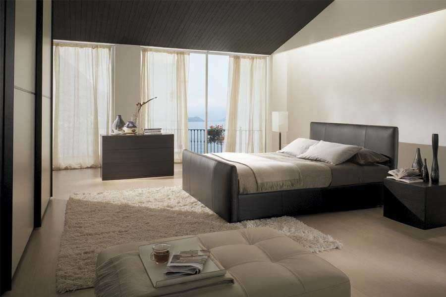 Letti in pelle foto design mag - Camera da letto marrone ...