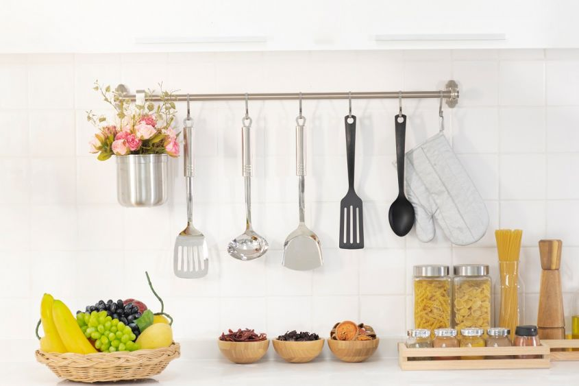 White,Kitchen,Wall,With,Utentils,Hanging,On,The,Wall.,Interior