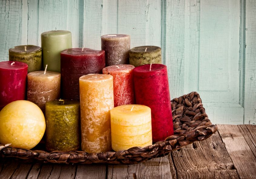 Collection,Of,Decorative,Candles,On,A,Rustic,Antique,Wooden,Background
