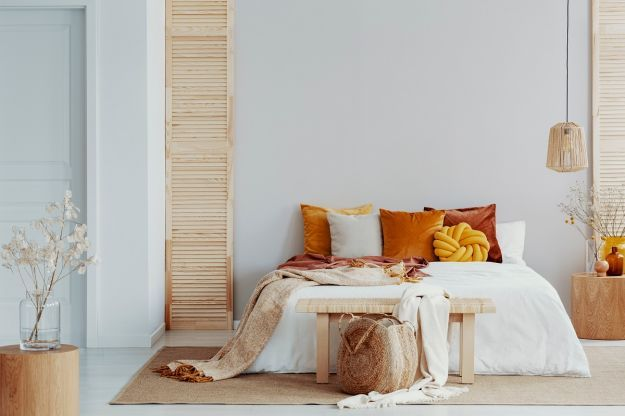 Brown,And,Orange,Pillows,On,White,Bed,In,Natural,Bedroom