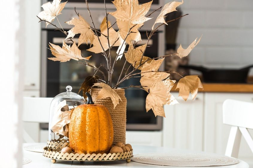 Branches,With,Golden,Leaves,And,A,Pumpkin,On,A,Tray.